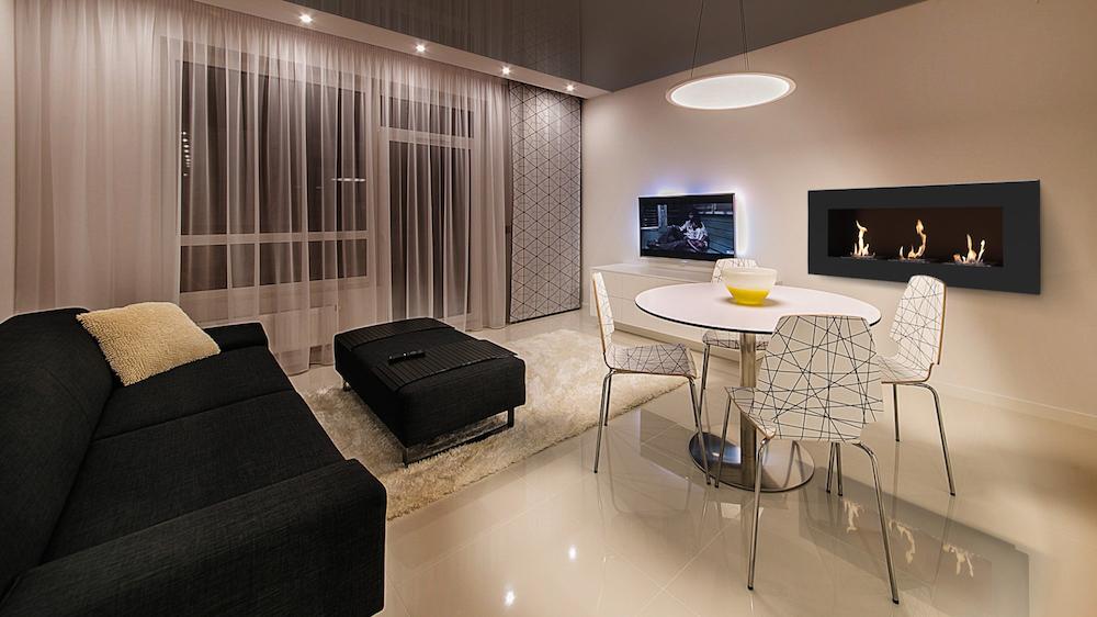 камин электрический в интерьере гостиной